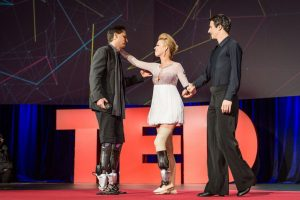 people with prosthetic legs on TED talk stage