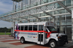 nanobus parked in front of JSNN building