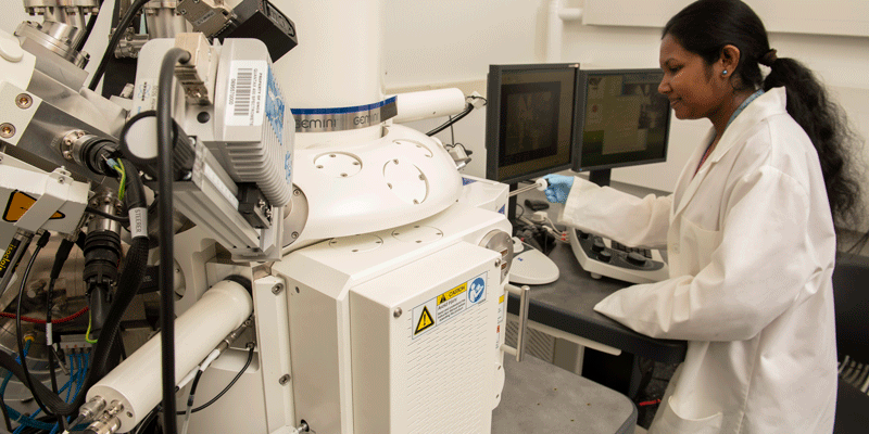 female scientist experimenting in lab